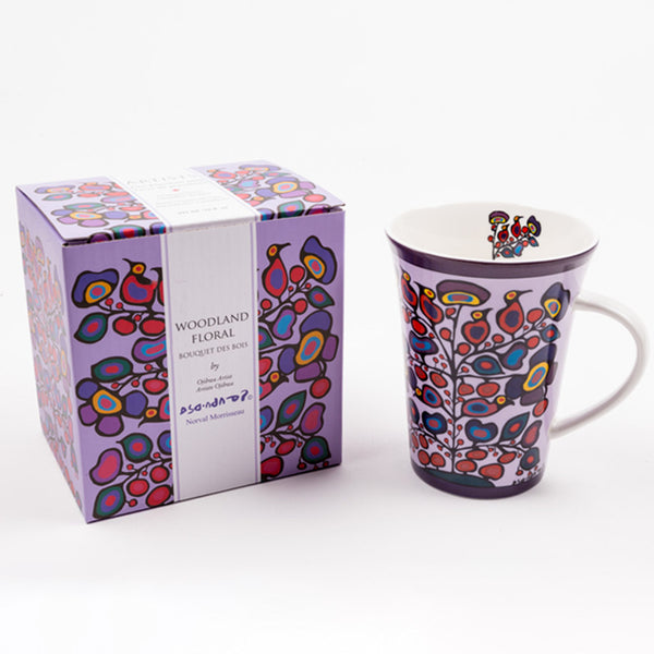 "porcelain mug with a floral design; beside it is a gift box with the text ""Woodland Floral"" and ""Bouquet des bois"" and a floral illustration that is similar to the mug's design"