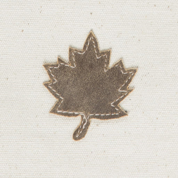 close-up of the maple leaf on the front of the bag