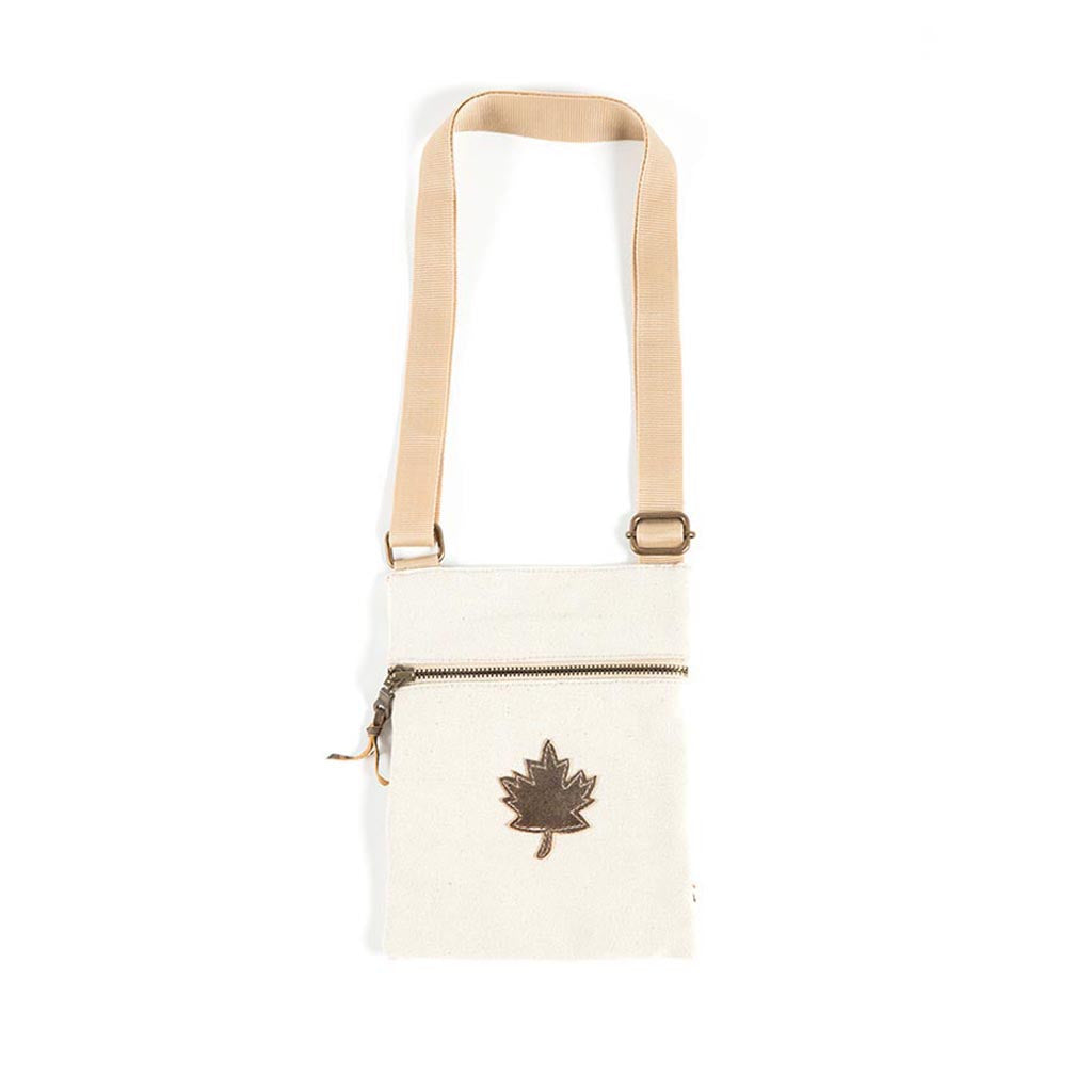 flat bag made of natural canvas that features a maple leaf