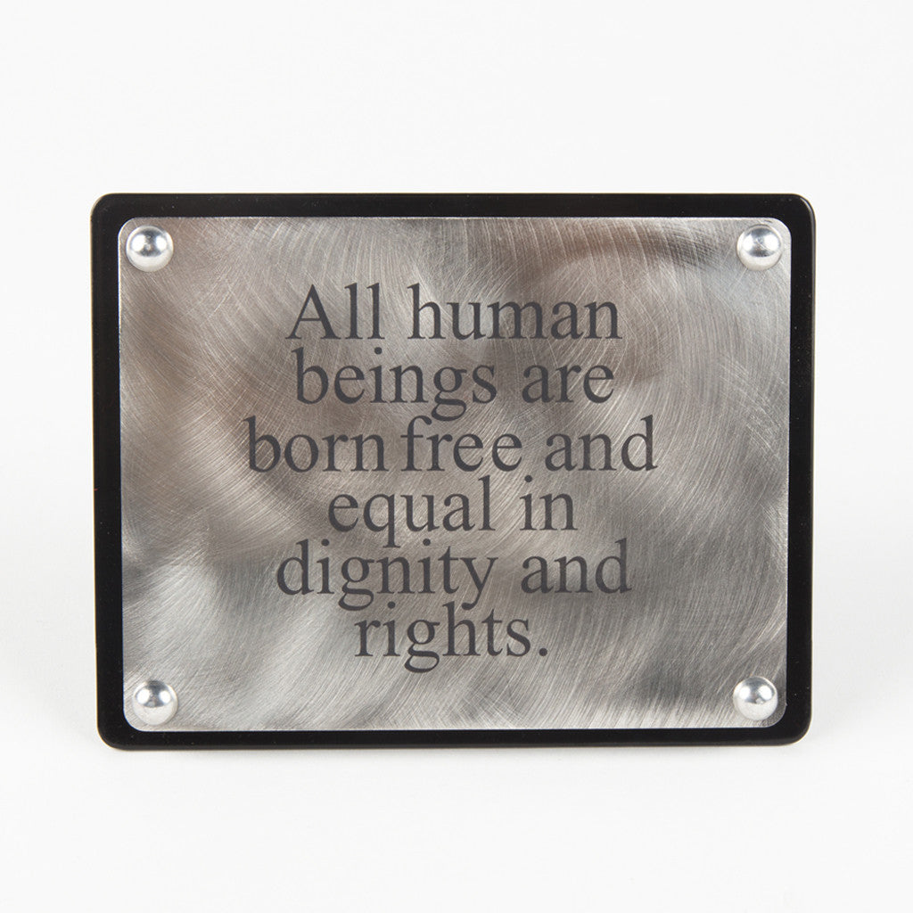 "a stainless steel plaque with the phrase ""All human beings are born free and equal in dignity and rights"""