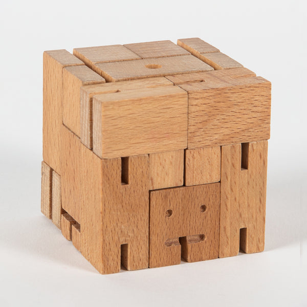 a wooden robot folded into a cube