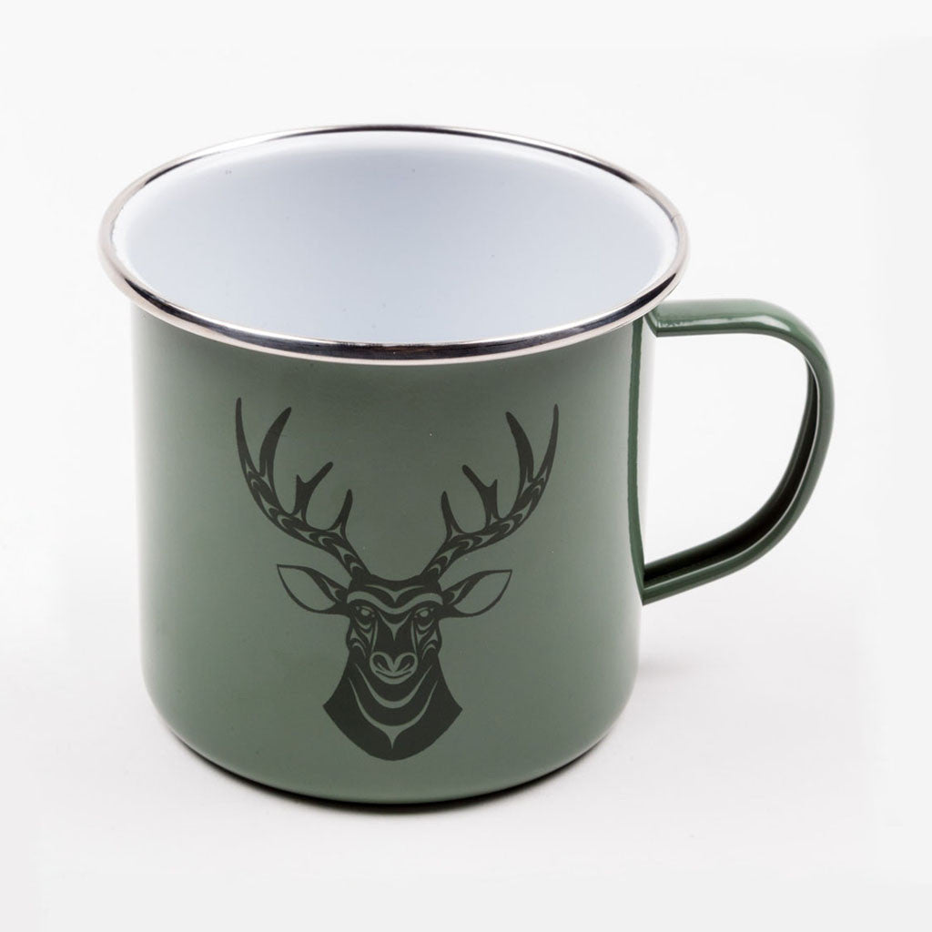 a green mug featuring artwork of a deer