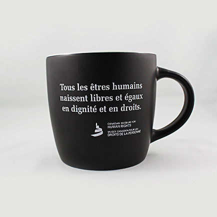 one black mug with white text printed on the exterior