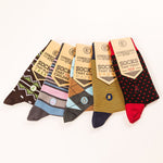 Five pairs of socks of different styles and in various colours