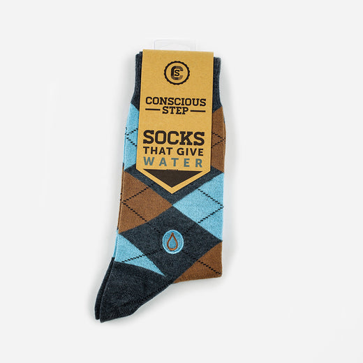 "a pair of socks with a tag reading ""Conscious Step: Socks that Give Water"""