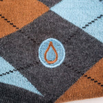 close-up of embroidered detail of a drop of water