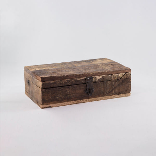 rectangular-shaped wooden box with an old-fashioned metal latch; box is closed