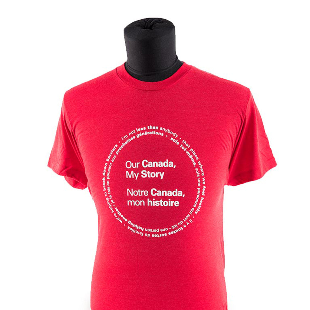 "a red shirt features the text ""Our Canada, My Story"", ""Notre Canada, mon histoire,"" printed in white; a circle composed of two lines of text surrounds the main text"