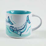 mug featuring a design of humpback whales