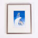 a framed art print featuring an Indigenous woman and a polar bear