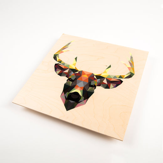 wood print featuring a geometric design of a deer