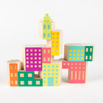 pastel-coloured building blocks stacked to form the shape of a building
