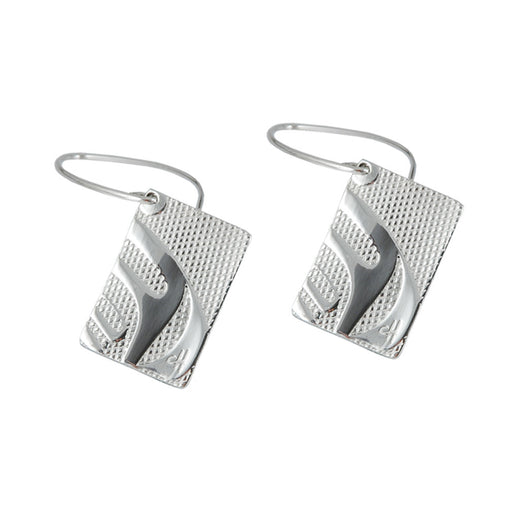 drop earrings that feature a design of a whale's dorsal fin
