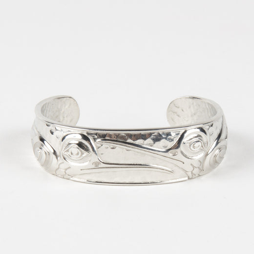 silver-coloured bangle featuring the design of a hummingbird