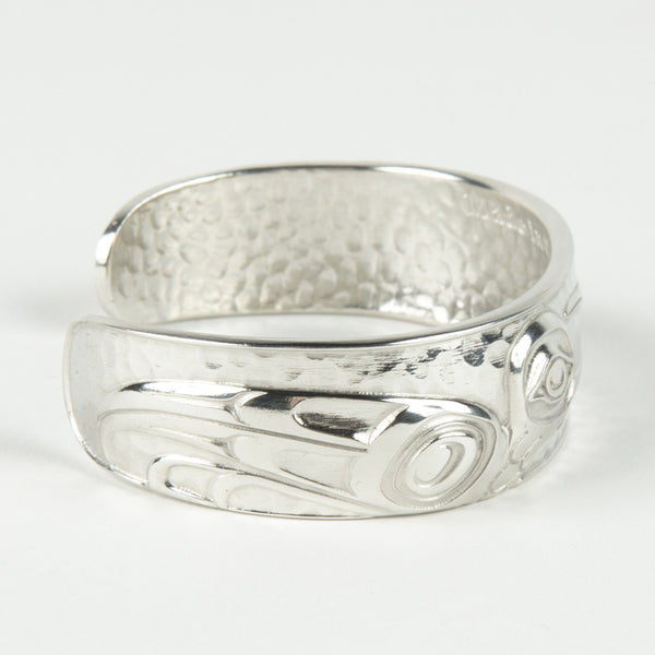 side view of a silver-coloured bangle featuring a design of a hummingbird