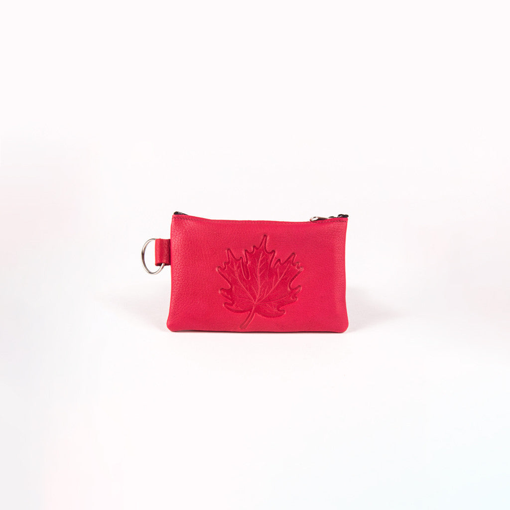 leather coin purse featuring a design of a maple leaf