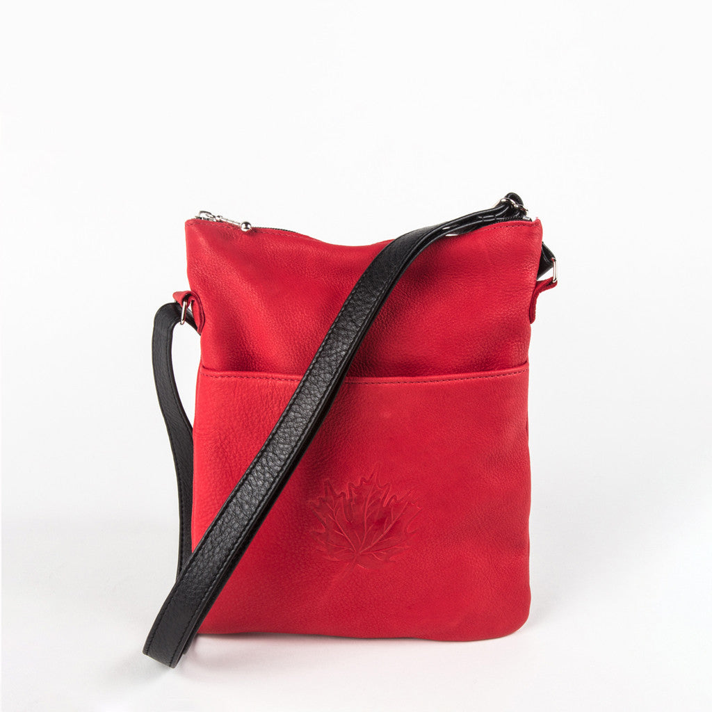 red leather bag featuring an embossed design of a single maple leaf