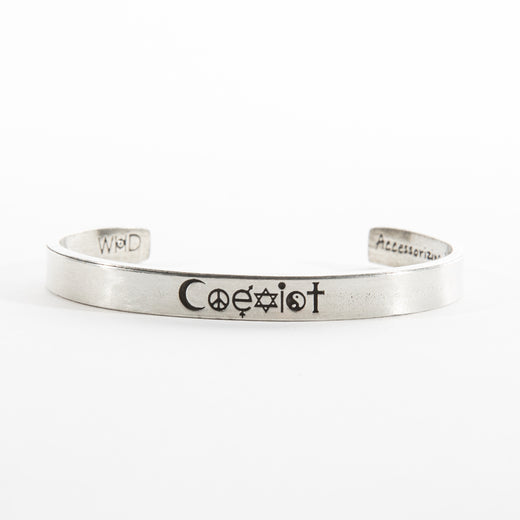 "the front of a pewter cuff with the word ""Coexist"" spelled out with icons, including: the crescent moon; the peace sign; the letter e with symbols for the male and female genders, respectively; the star of David; the wiccan symbol ""i""; the yin-yang; and the cross"