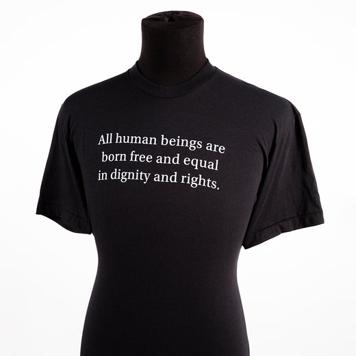 "a black t-shirt with the text ""All human beings are born free and equal in dignity and rights"""