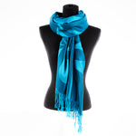 blue scarf featuring a design by Indigenous artist Justien Senoa Wood