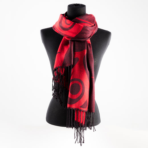 Red scarf featuring a red and black pattern designed by Indigenous artist Marcel Russ
