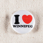 "close-up of a mini button pin that reads ""I (heart) Winnipeg"""