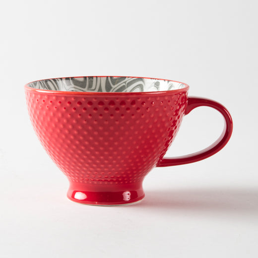 Red mug with a textured exterior
