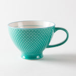 Turquoise mug with a textured exterior