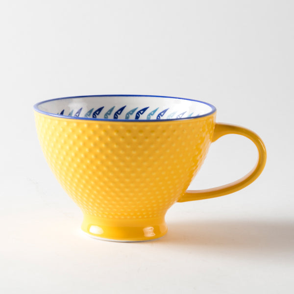 Yellow mug with a textured exterior