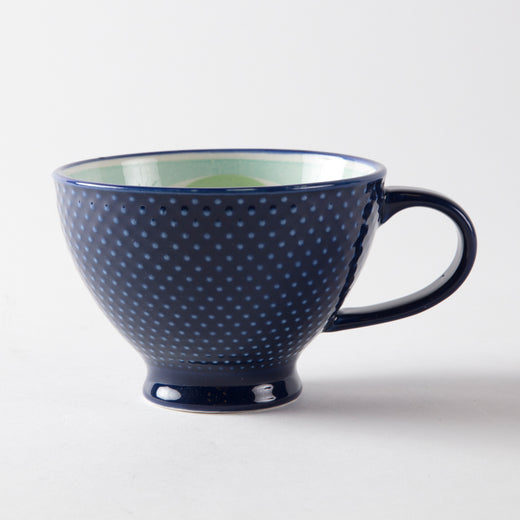 Blue mug with a textured exterior