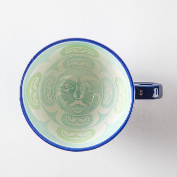 Interior of a blue mug featuring artwork of the moon
