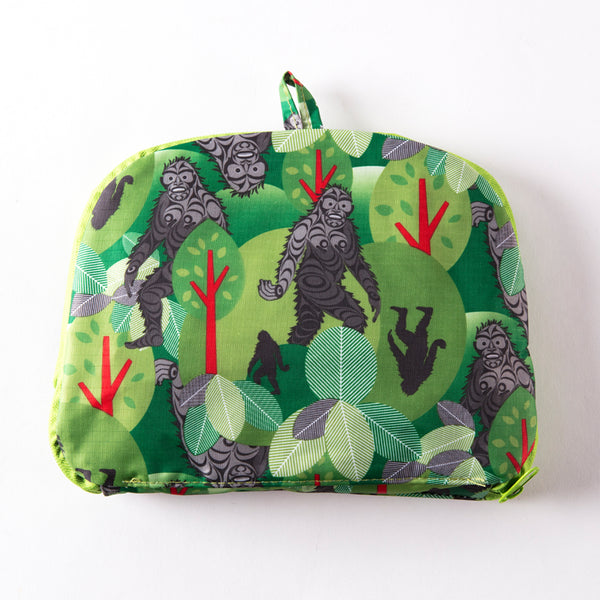 folded pouch featuring a patterned print of sasquatch in the forest