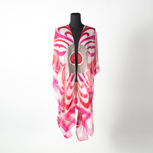 Pink and red sheer wrap featuring art by Gitxsan artist Trevor Angus