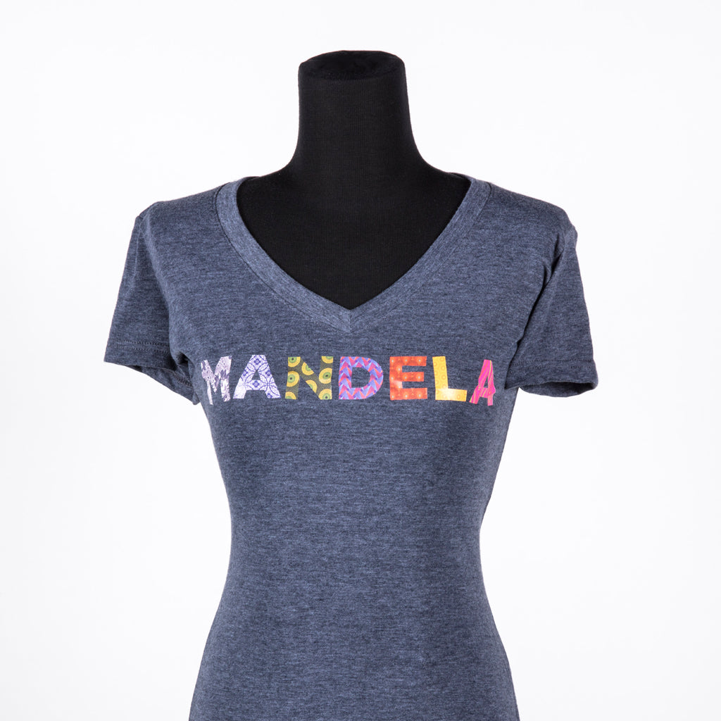 "Heathered denim V-neck shirt with the text ""MANDELA"" in multi-coloured and multi-patterned capital letters"