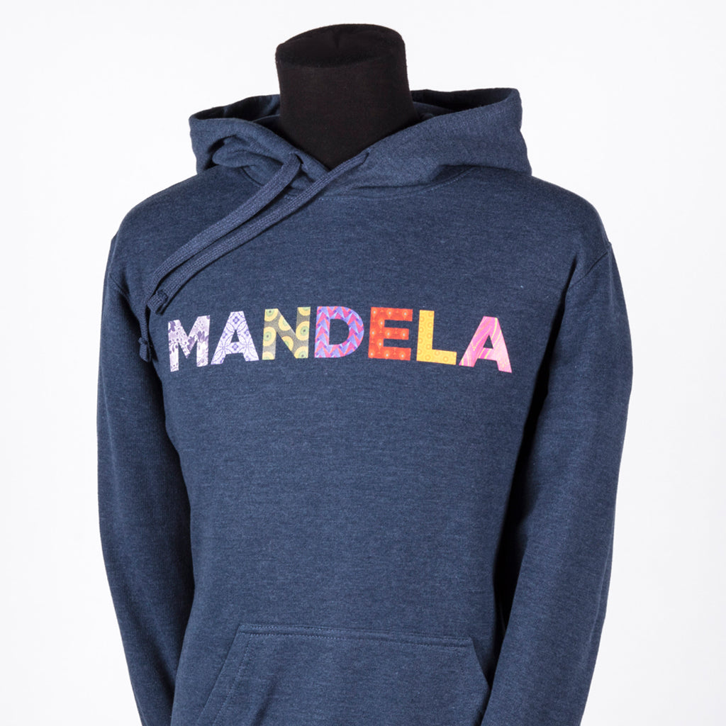 "heathered denim drawstring hoodie with the text ""MANDELA"" in multi-coloured and multi-patterned capital letters"