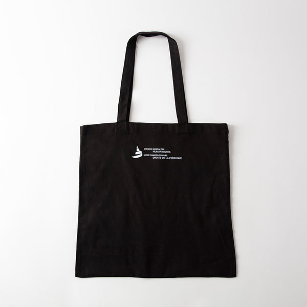 "back of a tote featuring the icon of the Museum and the text ""Canadian Museum for Human Rights"" and ""Musée canadien pour les droits de la personne"""
