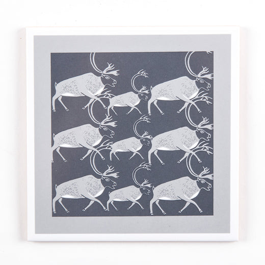 Grey and white square trivet/wall hanging featuring caribou