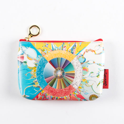 the front of a coin purse featuring art depicting an illustration of a circle, radiant lines and abstract shapes with vibrant colours