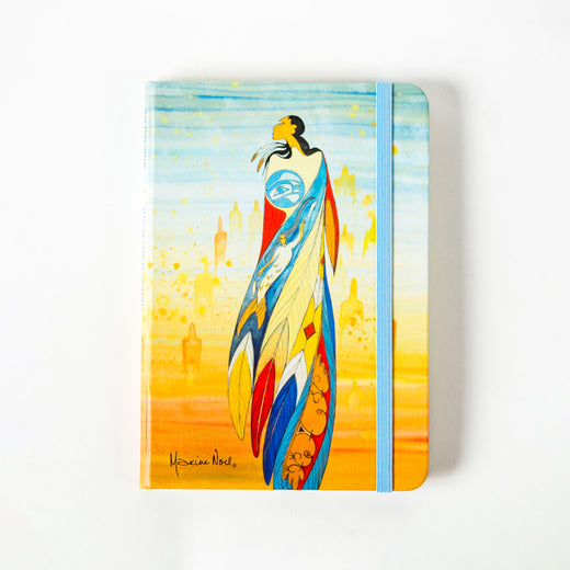 front of a journal featuring art depicting a Indigenous woman