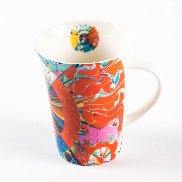 porcelain mug that features an illustration of a circle, radiant lines and abstract shapes with vibrant colours