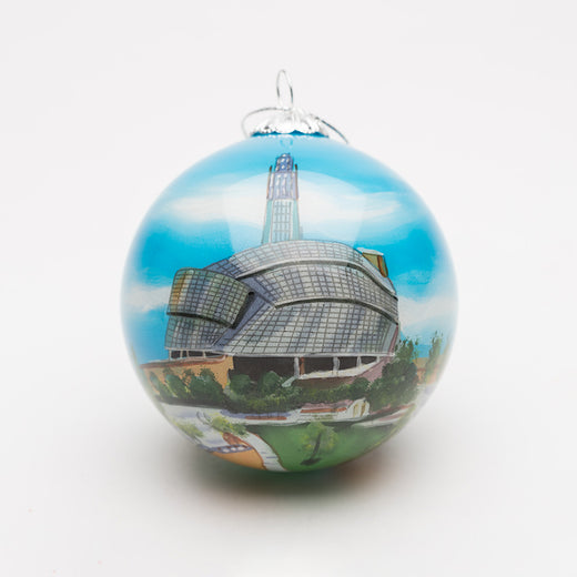 Spherical glass ornament featuring a hand-painted image of the Museum