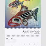 An inside page of the calendar showing the image for September of fish swimming through rays of light.