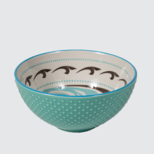 Light green textured bowl featuring an inner contemporary Indigenous pattern of a killer whale.
