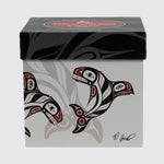 Mug box featuring killer whales and the artist's signature.
