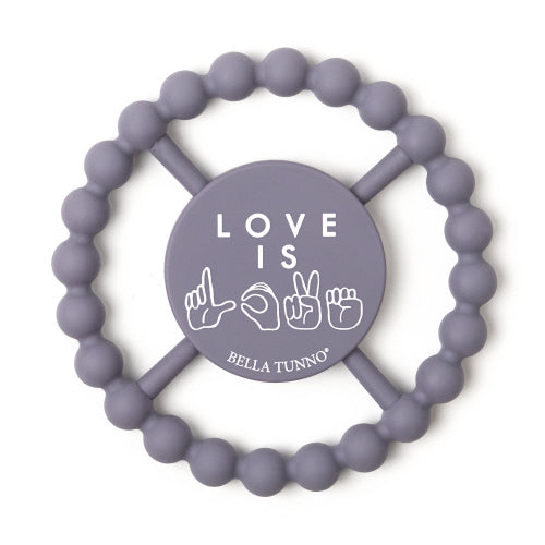"A grey-purple teether with the words ""LOVE IS LOVE"" printed in white in the centre. The second ""LOVE"" is printed in ASL hand symbols."
