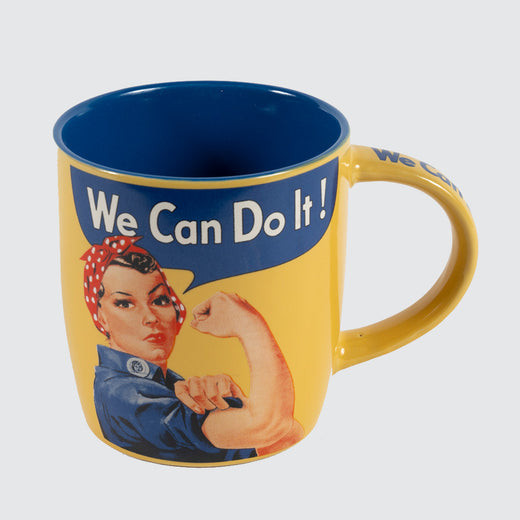 "A yellow mug with blue  on the inside and an image of Rosie the riveter saying, ""We Can Do It!"" in a speech bubble."