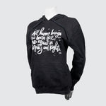 Black sweater with script on a mannequin.