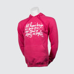 Pink sweater with script on mannequin.