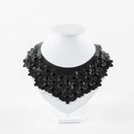 laser-cut, stitched faux leather necklace in black