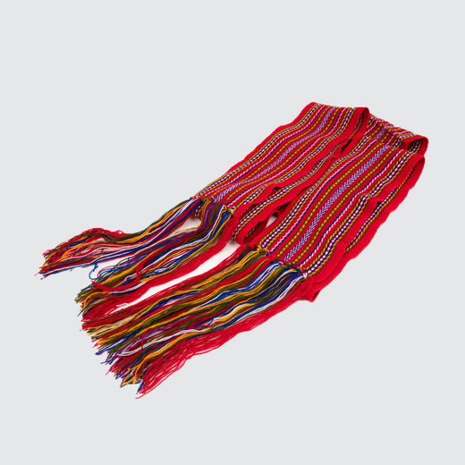 Weaved sash, mainly red with blue, white, green and yellow strands.